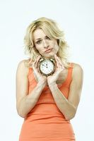 portrait-of-a-blonde-woman-holding-an-alarm-clock-7