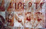 """Le mot """"Liberté"""" écrit par le sang de Kamel Irchene (Avril 2001)"""