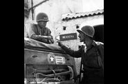 565px-Patton speaking with Lt. Col. Lyle Bernard, at Brolo,