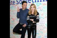 Madonna and Jimmy Fallon Sign The Facebook Wall 20120324 02