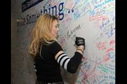 Madonna and Jimmy Fallon Sign The Facebook Wall 20120324 04