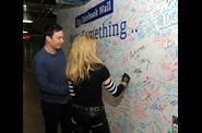 Madonna and Jimmy Fallon Sign The Facebook Wall 20120324 08