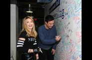 Madonna and Jimmy Fallon Sign The Facebook Wall 20120324 09