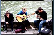 GUITAR PLAYERS along side the river
