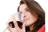 a-beautiful-woman-smell-a-red-glass-wine.jpg