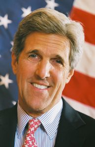 John Kerry headshot with US flag