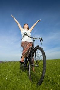 7199824-happy-young-woman-relaxing-over-a-vintage-bicycle.jpg