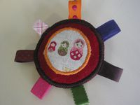 Broche aux matrioshka