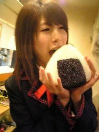 Hello Japan - School girl eats Onigiri