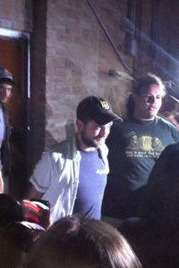 robert pattinson playing guitar in houston 2