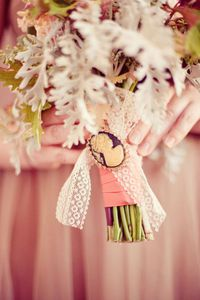flower-bouquet-wrapped-in-lace-and-cameo-brooch.jpg