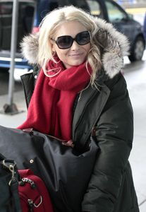 Myanna Buring Catching Flight Vancouver Airport