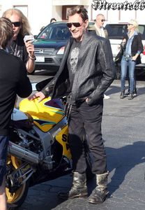 Johnny-Hallyday-Takes-Wife-Laeticia-On-A-Motorcycle-Ride--1.jpg