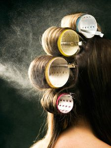 rby-woman-with-curlers-in-hair-spray-de[1]