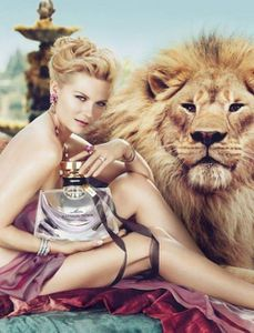 Kirsten-Dunst-Naked-With-A-Lion-For-Bulgari-500x655