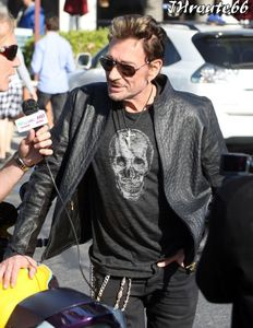 Johnny-Hallyday-Takes-Wife-Laeticia-On-A-Motorcycle-Ride-n1.jpg