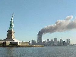 280px-National Park Service 9-11 Statue of Liberty and WTC