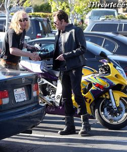 Johnny-Hallyday-Takes-Wife-Laeticia-On-A-Motorcycl-copie-10.jpg