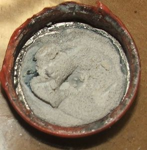 Lithium-after-reacting-with-water.JPG