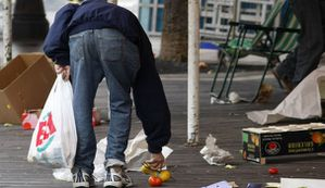 793063_a-man-picks-up-discarded-fruits-and-vegetables-after.jpg