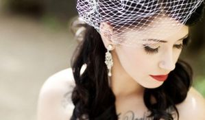 goth-bride-with-chest-tattoo-birdcage-veil-vintage-earings_.jpg