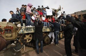 666314_protesters-put-their-children-on-an-army-tank-to-tak.jpg