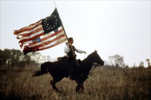 USA-patriot-gibson-riding-with-flag.jpg