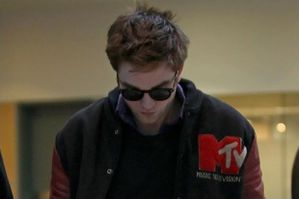 Rob Pattinson arriving @ VanCity airport 3