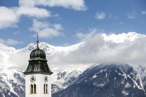507813-a-church-spire-is-pictured-in-front-of-the-nordkette.jpg