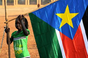 743192 a-girl-holds-a-south-sudan-flag-during-the-announcem