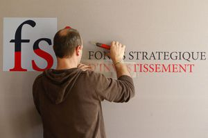 60271_a-man-installs-the-sign-of-the-france-s-strategic-inv.jpg