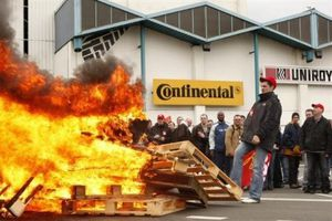 employees-at-continental-factory-stand-around-a-bonfire-as-.jpg