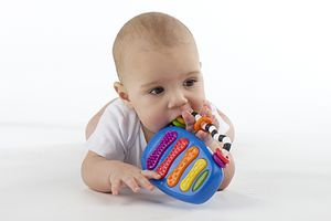 baby chewing on xylophone