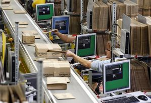 613157-workers-pack-boxes-at-amazon-s-logistics-centre-in-g.jpg