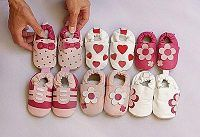 six-pairs-of-baby-shoes-on-display