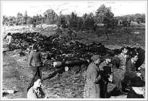 Klooga--Estonia--Survivors-beside-burnt-bodies--September-1.jpg