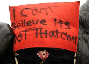 protester-holds-a-placard-007.jpg