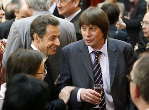 1-france-s-president-sarkozy-reacts-as-he-speaks-with-secre.jpg