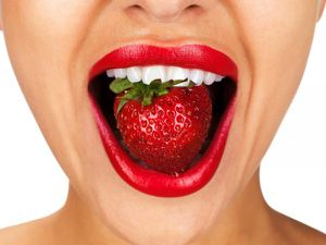 Woman-with-Strawberry-in-Mouth-e1363716718635.jpg
