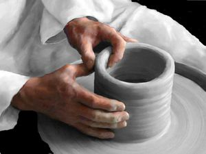 potter modling clay