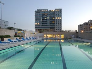 family apartment in Israel with pool at night in August mon