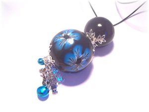 Bulan-bola-noir-fleur-bleue.jpg