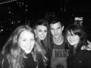 Taylor Lautner poses with fans in Vancouver
