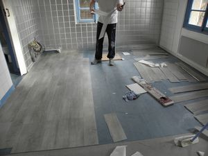 Parquet laminato flottante posa renovation devis angers for Revetement sol a poser sur carrelage