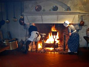 Sieur and Mme Sausin stoking the fire