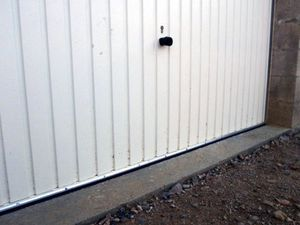 Isolation porte de garage bas de porte for Isoler bas de porte d entree