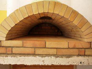 La face avant construction four a for Construction four a pain brique
