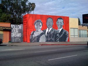 Term l from the power of words to leadership miss for Mural painted by street artist mr brainwash