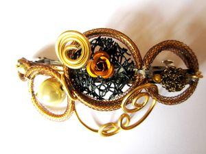 accessoires-coiffure-barrette-aux-volutes-dorees-3604037-ba