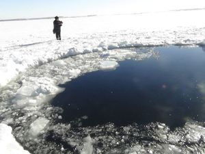 1474572_a-policeman-works-near-an-ice-hole-at-lake-chebarku.jpg